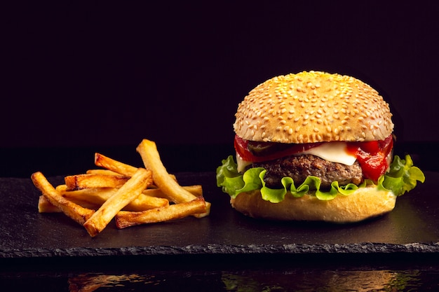 Front view burger with french fries Free Photo