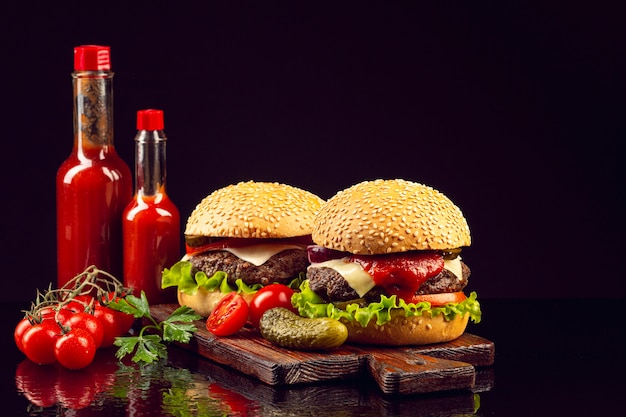 Front view burgers on cutting board Free Photo