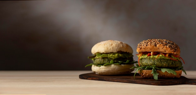 Front view burgers on tray with copy-space Premium Photo