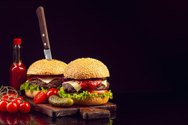 Front view burgers with black background Free Photo