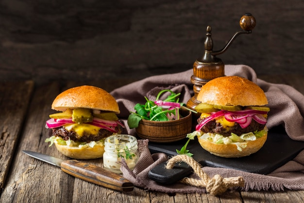 Front view burgers with pickles Free Photo
