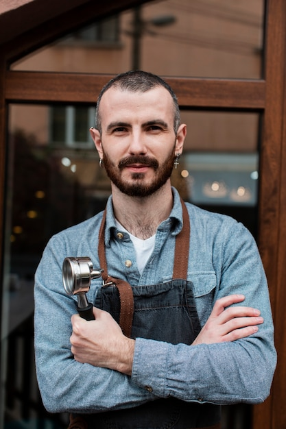 Front view business man with apron Free Photo