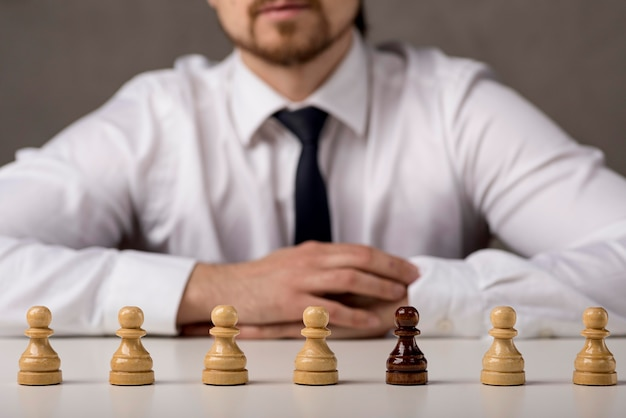 Front view of business man with pawns Free Photo