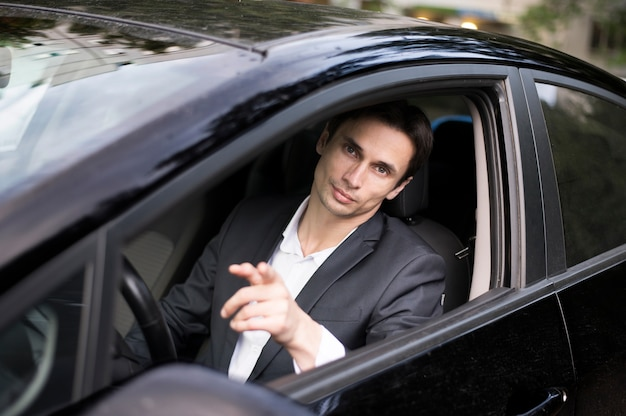 Front view of businessman in car Free Photo