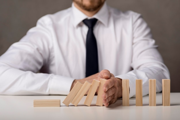 Front view of businessman with tie and dominoes Free Photo