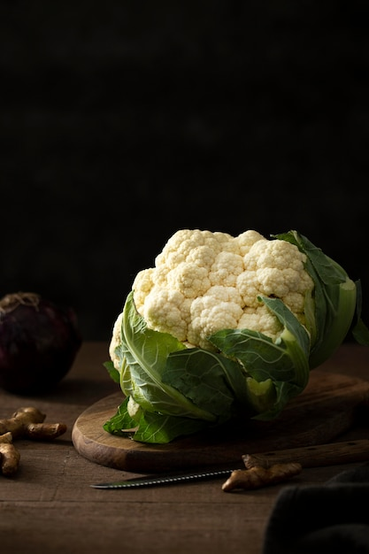 Front view cauliflower with leaves Free Photo