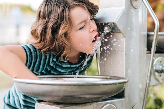 Front view of child drinking water Free Photo