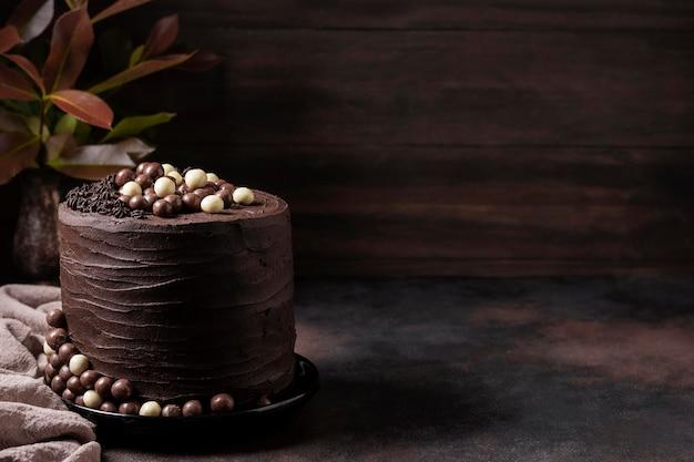Vista frontale del concetto di torta al cioccolato Foto Gratuite