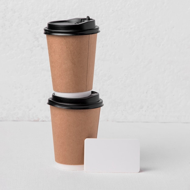Front view coffee paper cups with blank label Free Photo