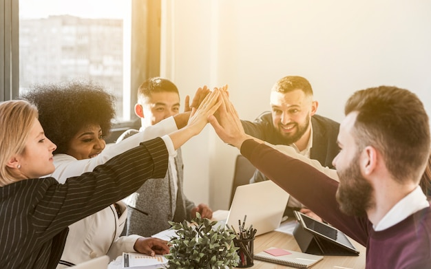 Front view of colleagues giving high five Premium Photo