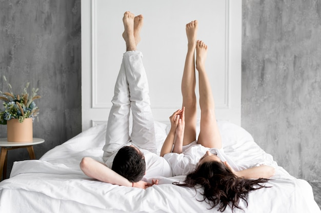 Front view of couple in bed at home Free Photo