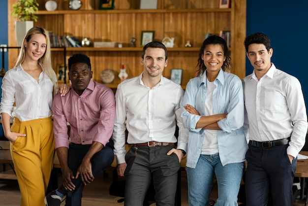 Front view of coworkers posing together at work Free Photo