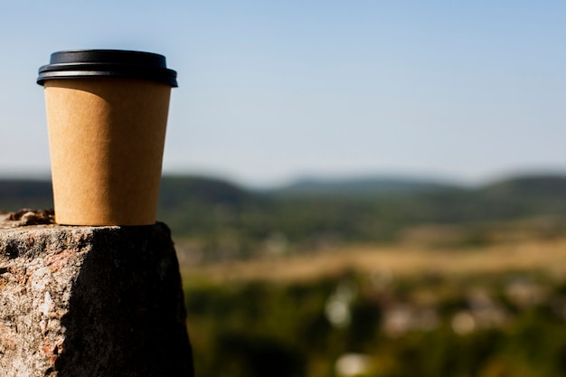 Front view cup of coffee with blural background Free Photo