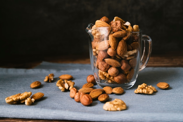 Front view cup full of healthy nuts Free Photo
