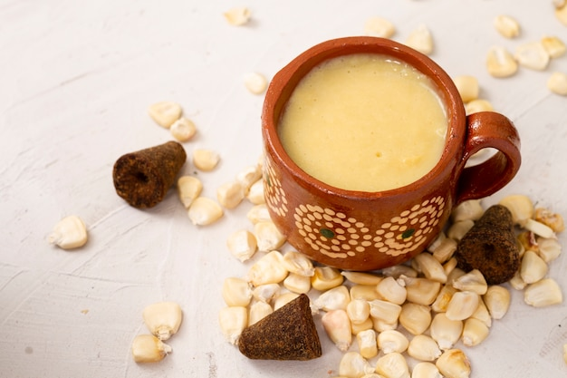 Front view cup of soup and corn grains Free Photo