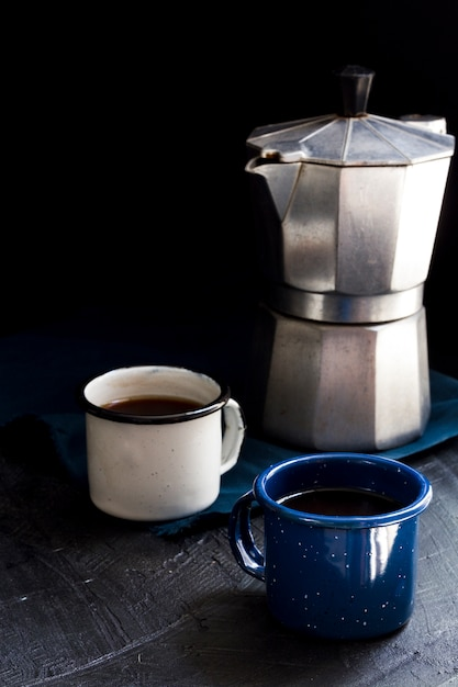 Front view cups of black coffee on table Free Photo