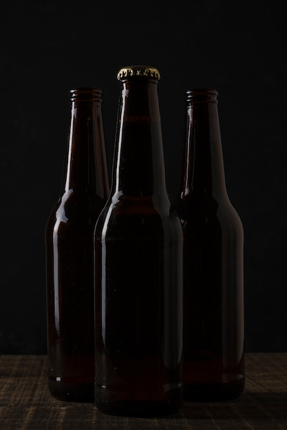 Front view dark colored bottles of beer Free Photo