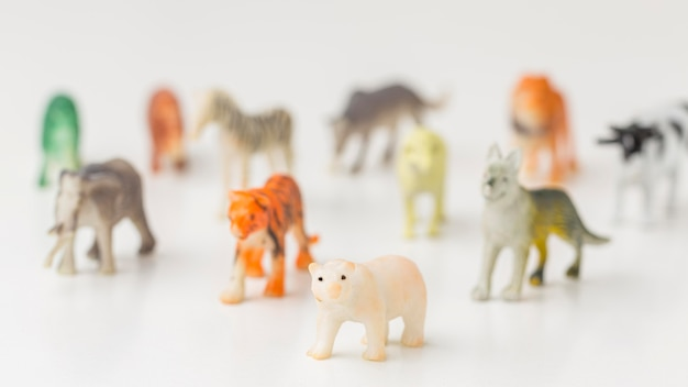 Front view of defocused animal figurines for animal day Free Photo