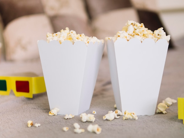 Front view delicious popcorn boxes Free Photo