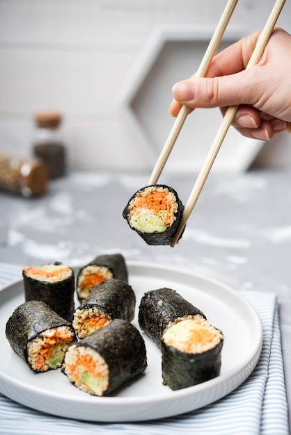 Front view delicious sushi rolls and blurred background Free Photo
