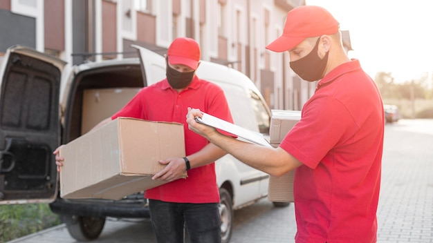Front view of delivery men at job concept Free Photo