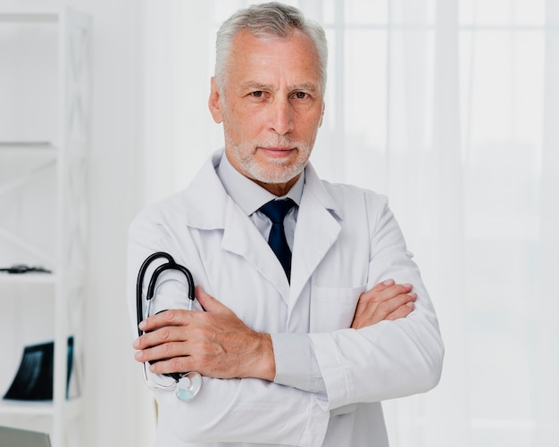 Front view of doctor holding stethoscope Free Photo