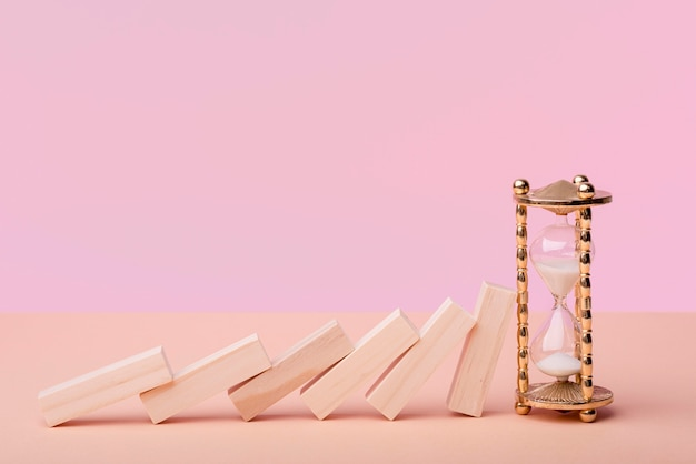 Front view of domino pieces with hourglass Premium Photo