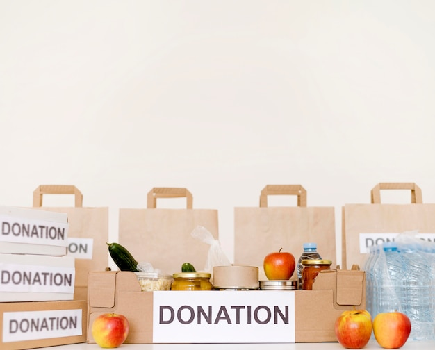 Front view of donation bags and boxes with copy space Free Photo