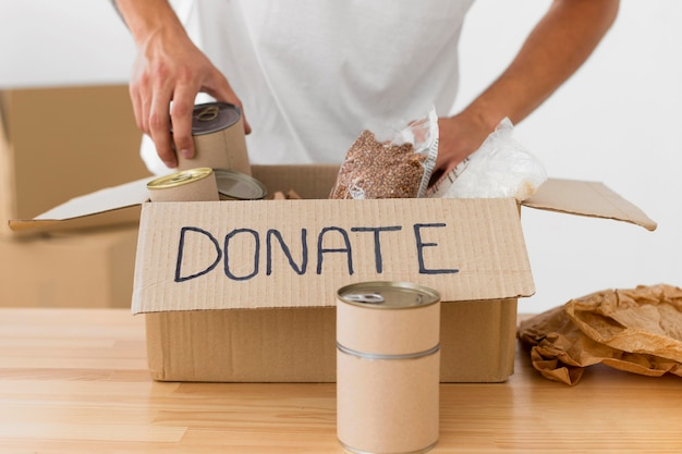 Front view donation box on wooden table Premium Photo