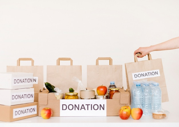 Front view of donation boxes and bags with food Free Photo
