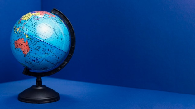 Front view of earth globe with copy space Free Photo