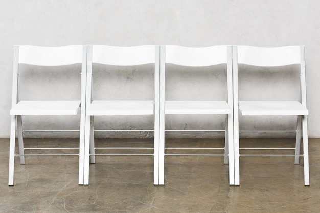Front view of empty chairs for people who wait for a job interview Premium Photo