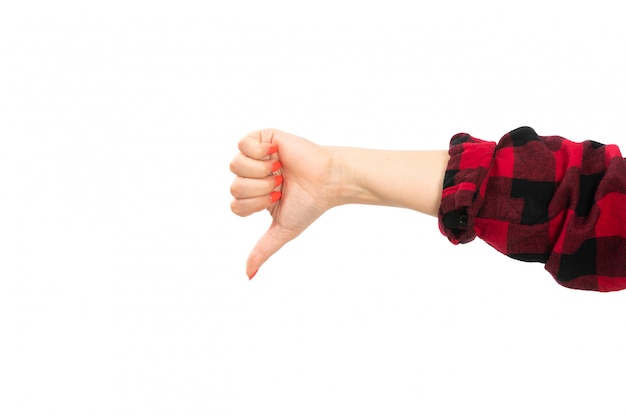 A front view female hand in black-red checkered shirt showing not cool sign on the white Free Photo