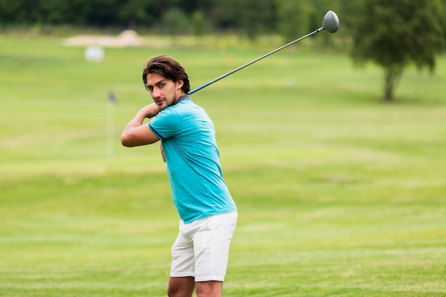 Front view fit man playing golf Free Photo