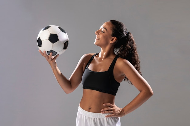 Front view fit woman holding ball Free Photo