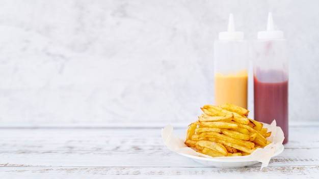 Front view french fries with copy space Free Photo