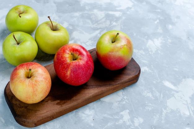 正面図新鮮なリンゴのまろやかな果実、薄白の表面の果実新鮮なまろやかな熟したビタミン 無料写真