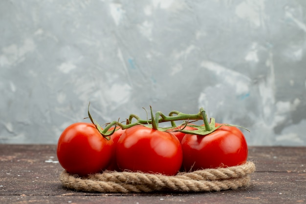 Front view fresh red tomatoes ripe and whole on white, with ropes vegetable fruit berry food color Free Photo