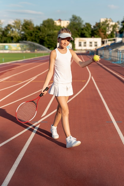 Front view of girl playing tennis Free Photo