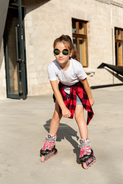 Front view of girl with roller blades Free Photo