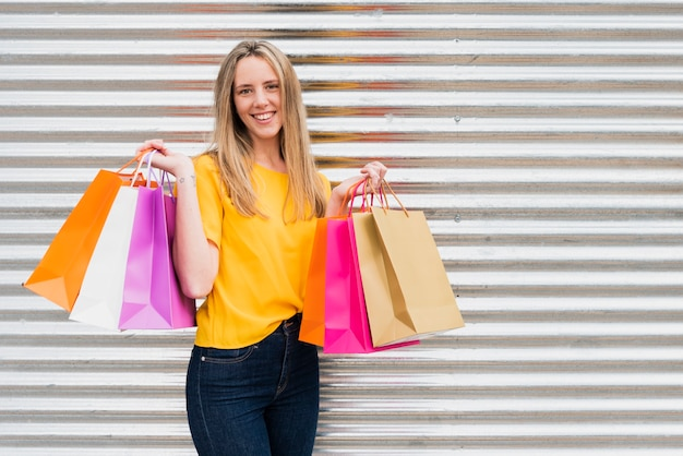 Front view girl with shopping bags Free Photo