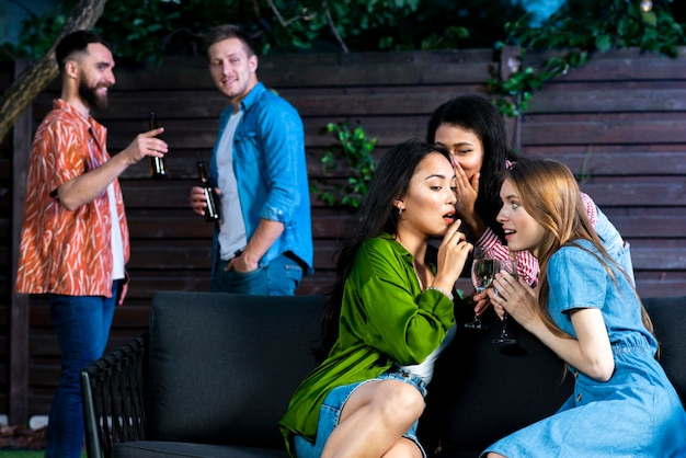 Front view girls with drinks gossiping Free Photo