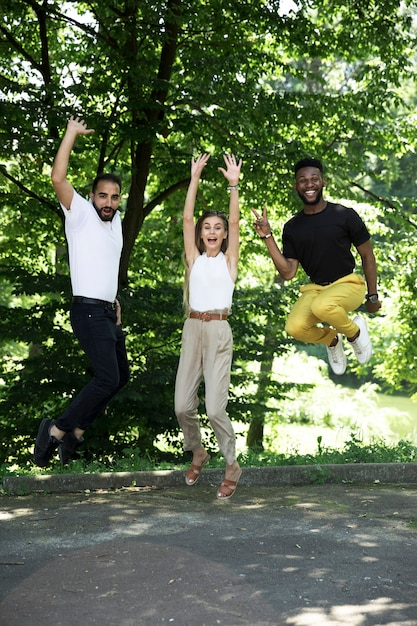 Front view group of friends jumping Free Photo