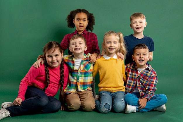 Front view group of smiley childrens Free Photo