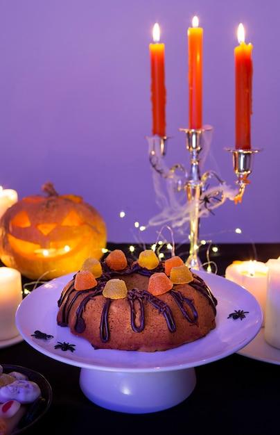 Vista frontale del concetto di zucca di halloween Foto Gratuite