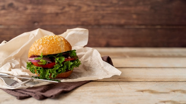 Front view hamburger with wooden background Free Photo