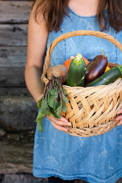 Front view hands holding basket with vegetables Free Photo