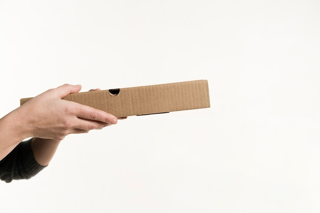Front view of hands holding pizza box Free Photo