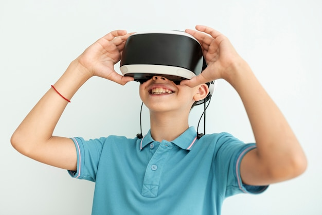 Front view happy child with vr glasses Free Photo