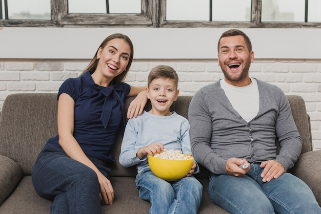 Front view happy family indoor Free Photo